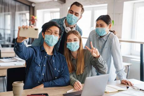 Photo Of Cheerful Students in Medical Masks Taking